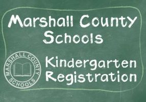 Green chalkboard with Marshall County Schools Kindergarten Registration written in white chalk