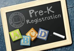 Chalkboard with Pre-K Registration written in chalk